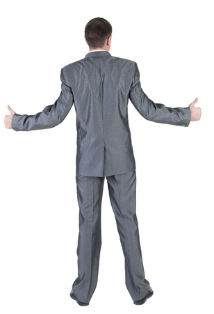 Businessman thumbs up. rear view. Isolated over white . Stock Photo - 10864685