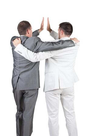 Two joyful businessmen with success gesture . Rear view. Isolated over white background. photo