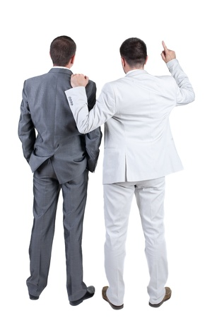 business dilemma: Two businessmen discuss. Rear view. Isolated over white background.
