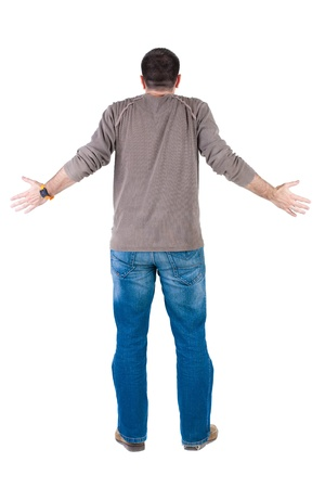 Back view of shocked and scared young  man. Rear view. Isolated over white background. photo