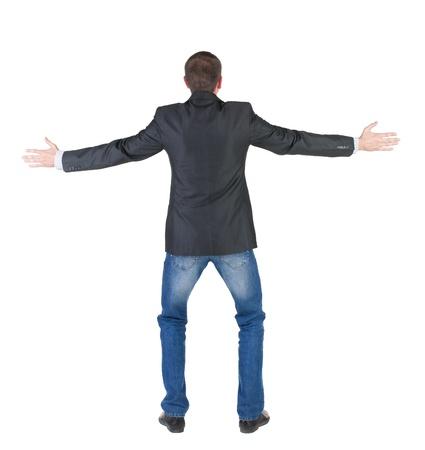 Volver la vista de hombre de negocios conmocionado y asustado joven. Toma de las manos hacia arriba. Vista trasera. Aislado sobre fondo blanco. Foto de archivo