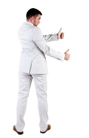 Back view of young business man in white suit going thumb up, isolated on white background. Rear view.Showing of positive emotions with OK sign concept . Stock Photo - 11016467