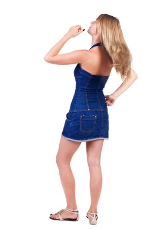 Back view of  thinking young beautiful woman. Rear view. isolated over white background. Concept of idea, ask question, think up, choose, decide. photo