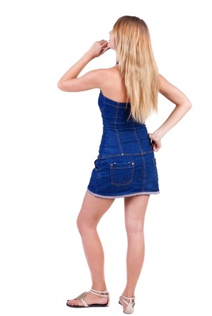 side views: Back view of  thinking young beautiful woman. Rear view. isolated over white background. Concept of idea, ask question, think up, choose, decide. Stock Photo
