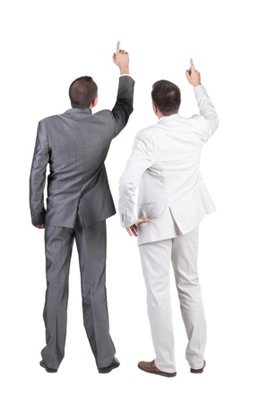 side pose: Back view of two businessman pointing at wall. rear view. Isolated over white .  Stock Photo