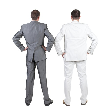 side pose: Back view of Two business men.  Rear view. Isolated over white background.