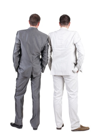 business dilemma: Back view of Two business men.  Rear view. Isolated over white background.