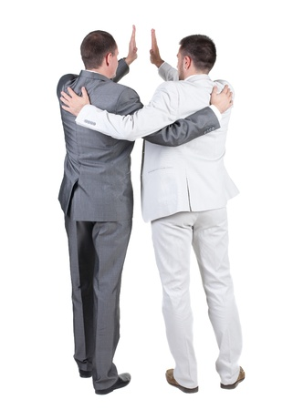back view of two joyful businessmen with success gesture . Rear view. Isolated over white background. photo