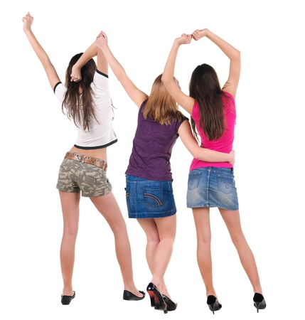 Back view of dancing young women. Dance party. girls dance, enjoy and express positive emotions and having fun.  Rear view. Isolated over white. photo