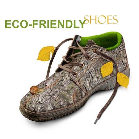 Eco-friendly shoes. Concept. Shoes made of natural materials. Winter shoes from the bark of a tree, grass and leaves. Isolated over white background. photo