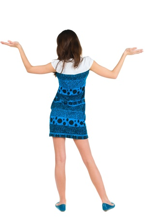 back view of surprised beautiful  young woman with hands up. Girl in blue dress. Rear view. Isolated over white  Stock Photo - 13148180