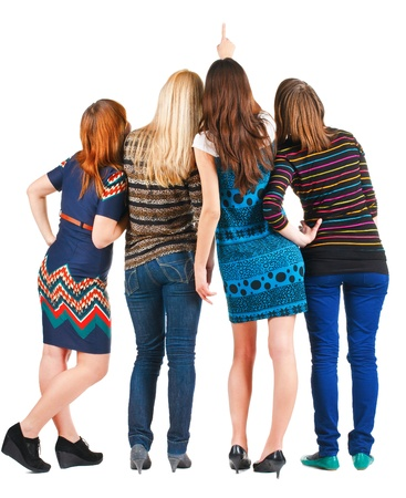 Back view of group beautiful women pointing at wall. Girls team Girl friends looks into the distance. Rear view people. Isolated over white background. photo
