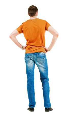 Back view of young men in  orange t-shirt. Guy looks at wall. Rear view. Isolated over white background Stock Photo - 13148181