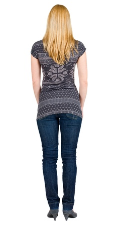 back view of standing beautiful blonde woman. Young girl in jeans . Rear view. Isolated over white background photo
