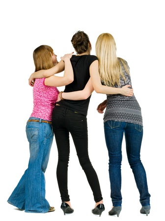 back view of group of young women discussing and watching . girlfriends together. Rear view people. Isolated over white background. photo