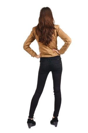 back view of standing beautiful brunette woman. Young girl in jacket. Rear view. Isolated over white background
