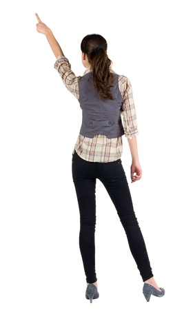 side job: Back view of young brunette woman pointing  . beautiful girl in shirt gesture. Isolated over white background. Rear view.
