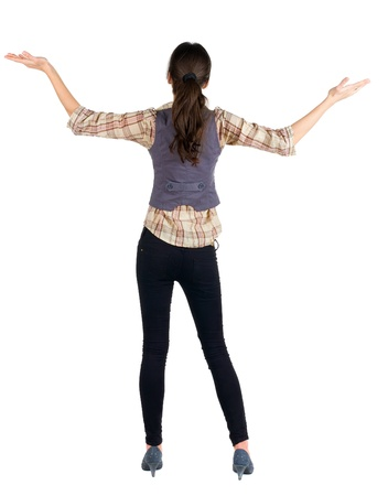 Back view of of beautiful brunette woman in jeans and shirt. Showing of positive emotions.  Rear view people collection.  backside view of person.  Isolated over white background. photo