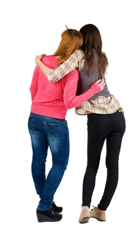 Back view of two young girl (brunette and blonde) pointing at wall . Rear view people collection.  backside view of person. beautiful woman friends  showing gesture. Rear view. Isolated over white background. Stock Photo - 13356313