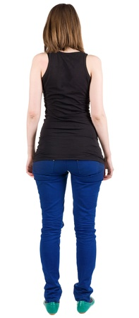 back view of standing beautiful brunette woman . Young girl in jeans and a shirt .  Rear view people collection.  Isolated over white background.  backside view of person.  Isolated over white background. Stock Photo - 13355811