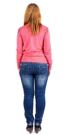 back view of standing beautiful brunette woman . Young girl in jeans and a sweater . Rear view people collection. Isolated over white background. backside view of person. Isolated over white background.