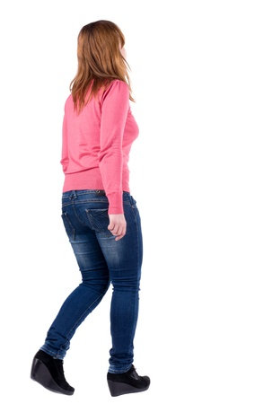 back view of going brunette girl in red. woman in motion. Rear view people collection.  backside view of person. Isolated over white background. Stock Photo - 13355756
