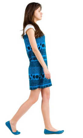 from side: back side view of going young brunette girl . beautiful woman in blue dress in motion.  backside view of person. Isolated over white background. Rear view people collection.