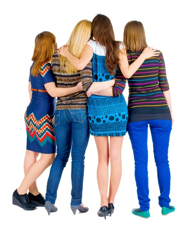backside: back view of group of young women discussing and watching . girlfriends together. Rear view people collection.  backside view of person. Stock Photo
