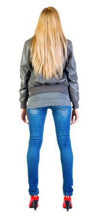 back view of standing beautiful blonde woman. Young girl in jacket, jeans and red kitten heels. Rear view people collection.  backside view of person.  Isolated over white background Stock Photo - 13355860