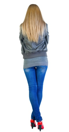 back view of standing beautiful blonde girl. Young woman in jacket, jeans and red kitten heels. Rear view people collection. backside view of person. Isolated over white background