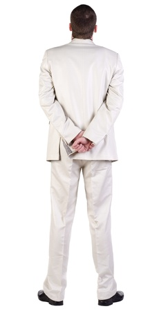 back view of Business man  looks ahead. Young guy in white suit watching. rear view. Isolated over white background.  photo