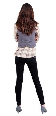personas de pie: mujer de negocios. parte trasera. hermosa morena de pie. Ni�a mirando hacia el futuro de la yoursel. Vista posterior recogida de las personas. trasero vista de la persona. Aislado sobre fondo blanco. Foto de archivo