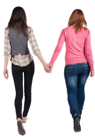 Back view going of two young girl (brunette and blonde)  . Rear view people collection.  backside view of person. beautiful woman friends  walking. Rear view. Isolated over white background.   Stok Fotoğraf