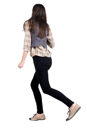 back view of running brunette girl. girl walking on the motion move. Rear view people collection.  backside view of person. Isolated over white background. Stock Photo - 13570051