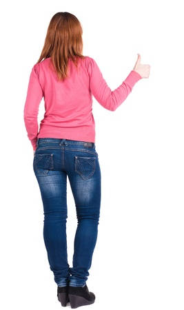 Back view of young beautiful woman  going thumb up. Showing of positive emotions with OK sign concept . Rear view people collection.  backside view of person.  Isolated over white background. photo