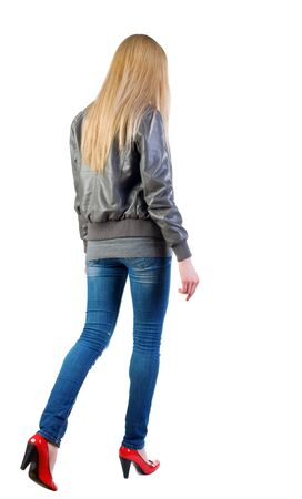 walking blonde girl in motion. during a walk.  going woman back view . Rear view people collection.  backside view of person.  Isolated over white background. Stock Photo - 13572474