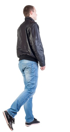 Back view of walking handsome man in jacket.   going young guy in jeans and  jacket. Rear view people collection.  backside view of person.  Isolated over white background. Stock Photo - 13570044