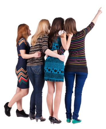 Back view of group beautiful women pointing at wall. Girls team. Girl friends looks into the distance. Rear view people collection.  backside view of person. Isolated over white background