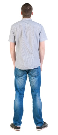 Back view of young men in  shirt and jeans.  Guy  looks away. Rear view people collection.  backside view of person.  Isolated over white background. photo