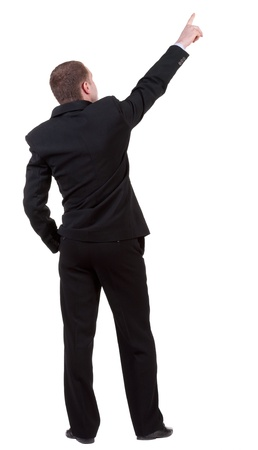 pointing up: Back view of pointing business man. gesticulating young guy in black suit.