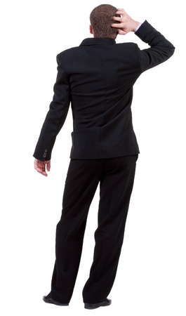 Back view of thinking business man. gesticulating adult businessman in black suit . Rear view people collection.  backside view of person.  Isolated over white background. Imagens