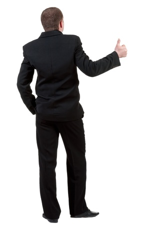 back view of business man thumbs up. rear view. Isolated over white . photo