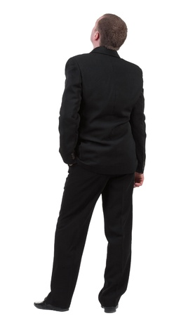 backwards: backside view of person. back view of Businessman watching. Young guy in black suit looks ahead.  Rear view people collection.    Isolated over white background