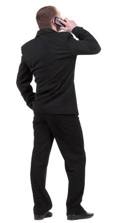 back  view people collection. Rear view of business man in black suit  talking on mobile phone.   photo