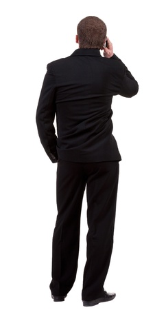 back  view people collection. Rear view of business man in black suit  talking on mobile phone.  Isolated over white background. backside view of person.  photo
