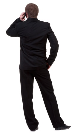 back  view of business man in black suit  talking on mobile phone. people collection.  photo