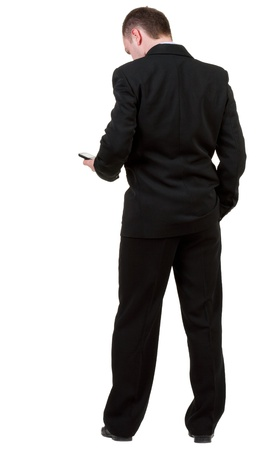 back view of business man in black suit  talking on mobile phone.     photo