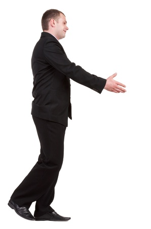 side job: going businessman  in black suit  handshake.   Isolated over white background.
