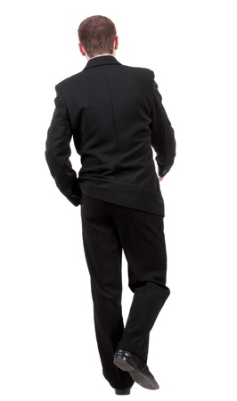 treading: back view of going business man. walking young guy in black suit. Rear view people collection.  backside view of person.  Isolated over white background.