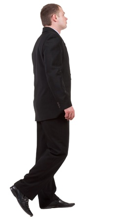 back view of going business man. walking young guy in black suit. Isolated over white background. Rear view people collection.  backside view of person.   photo
